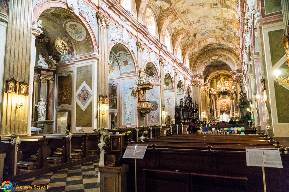 Interior of Velehrad basilica has ornately painted ceilings and a checkerboard floor