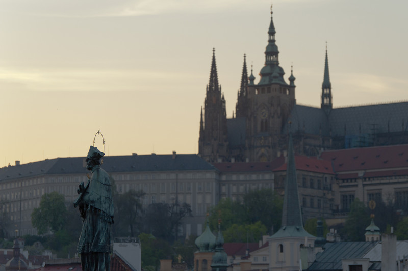 John of Nepomuk statue with Prague Castle in background - Prague, Czech Republic