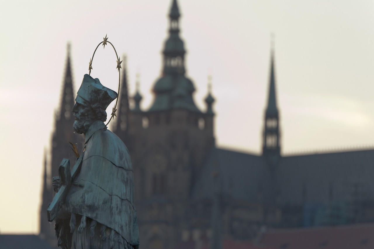 Close-up of John of Nepomuk statue in Charles Bridge - Prague, Czech Republic
