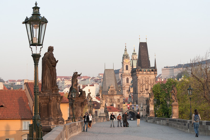 Tourists shooting at the Charles Bridge at sunrise - Prague, Czech Republic