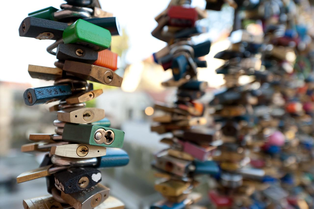 Close-up shot of locks at a bar in Charles Bridge - Prague, Czech Republic