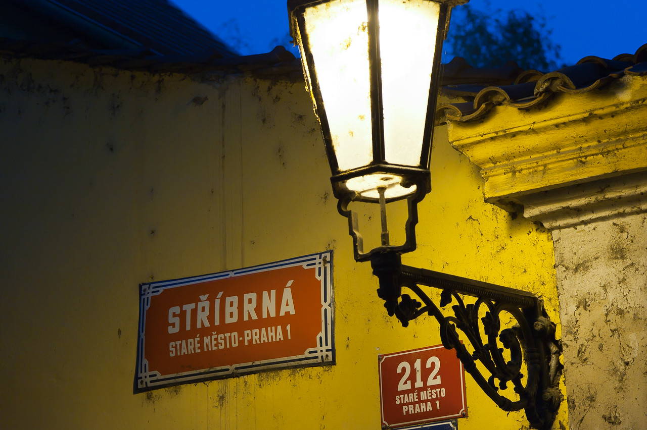 Sign and lamp post in a building at Old Town Square - Prague, Czech Republic
