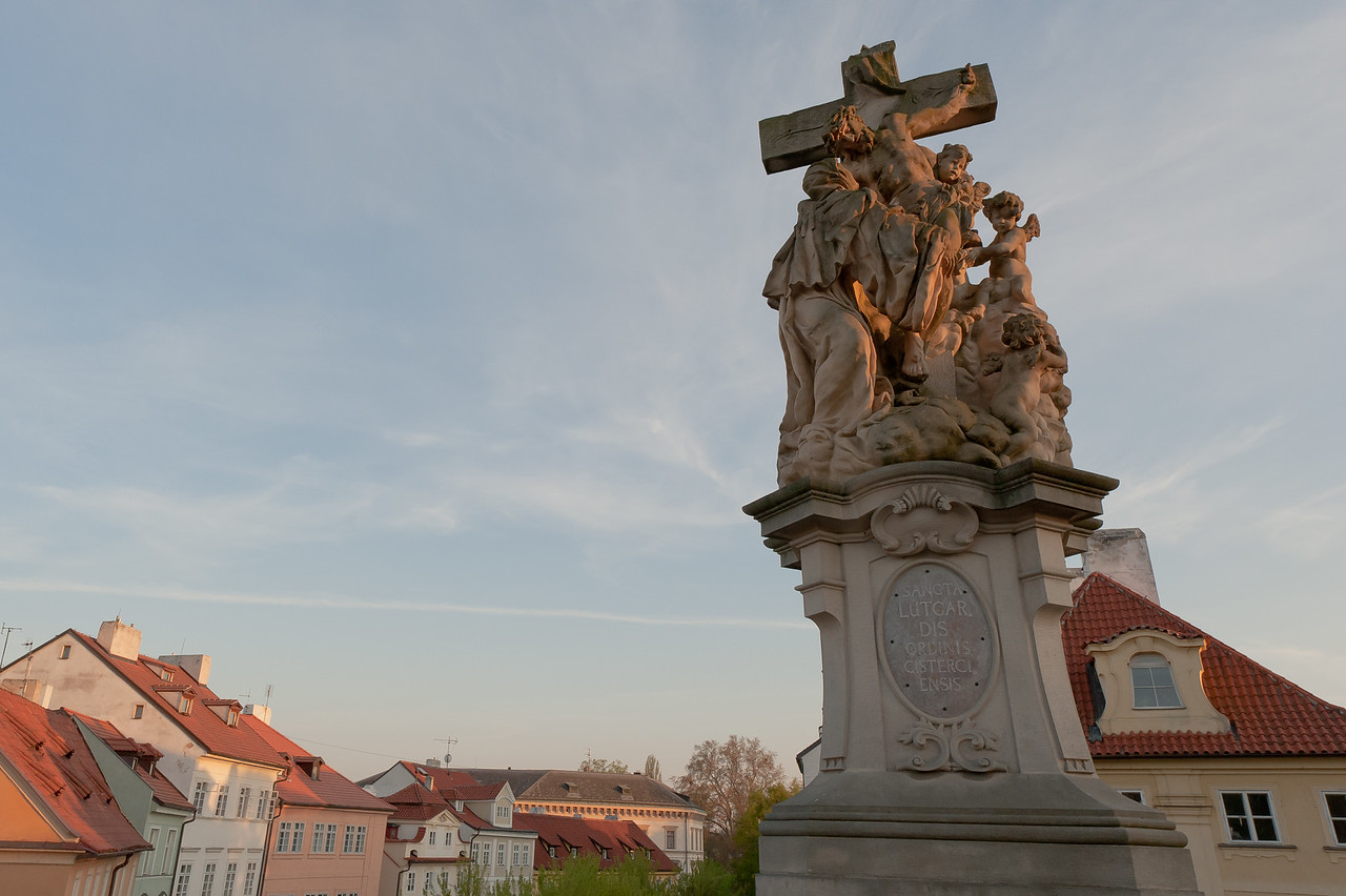 Crucified Christ with angels statue in Charles Bridge, Prague - Czech Republic