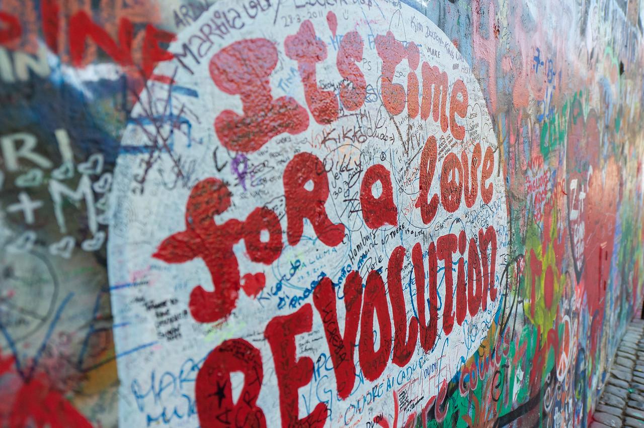 Close-up shot of a graffiti in Lennon Wall - Prague, Czech Republic