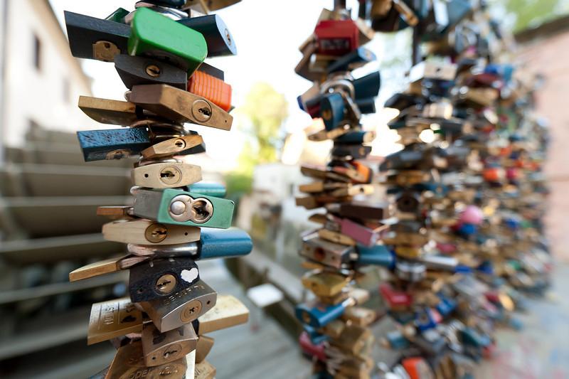 More love locks at a canal near Charles Bridge - Prague, Czech Republic