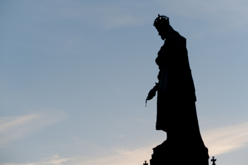 Silhouette of a statue on Charles Bridge - Prague, Czech Republic
