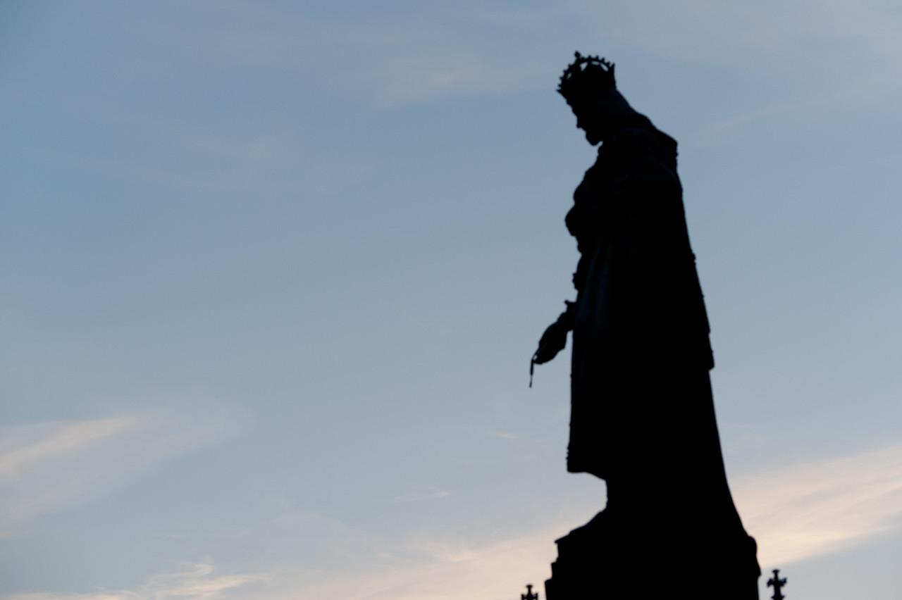 Silhouette of a statue on Charles Bridge - Prague, Czech Republic