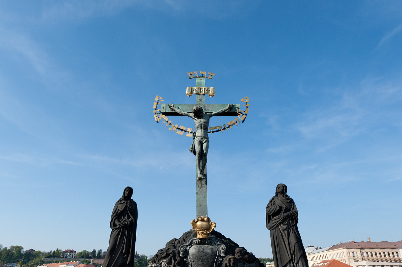 The statue of Jesus Christ crucified in cross in Charles Bridge  - Prague, Czech Republic