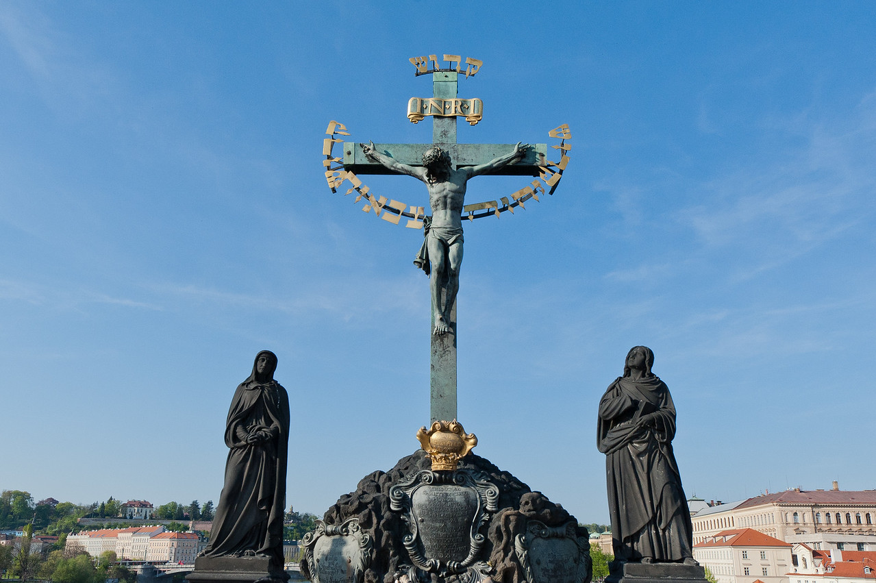 Statue of crucified Jesus Christ in Charles Bridge - Prague, Czech Republic