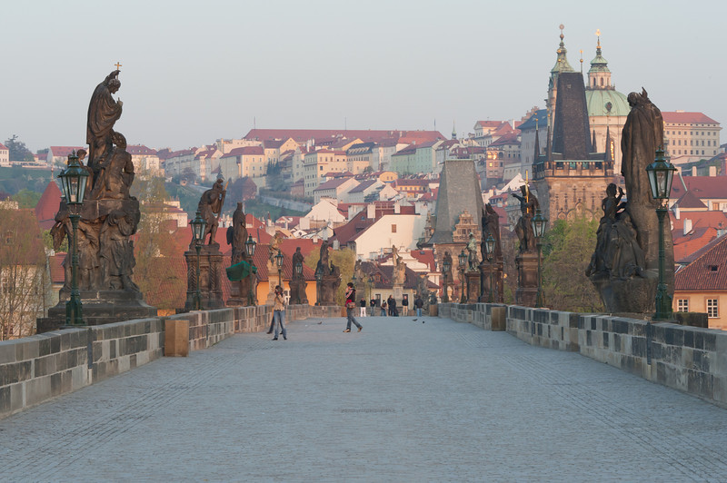 Tourists exploring the sights at Charles Bridge in Prague, Czech Republic
