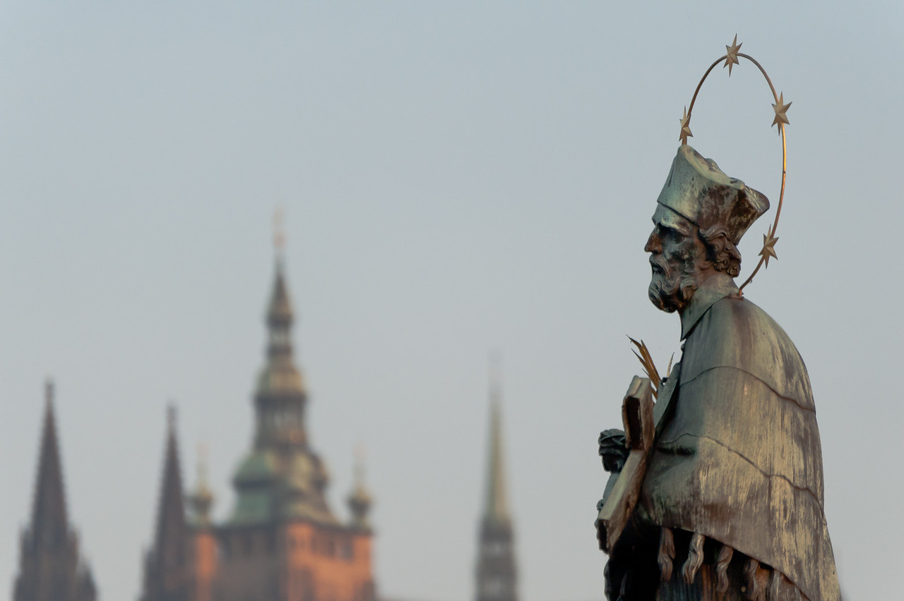 Side profile of John of Nepomuk statue in Charles Bridge - Prague, Czech Republic
