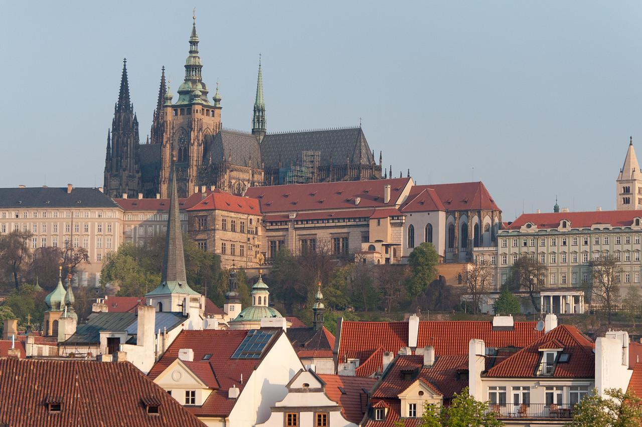 View of the Prague Castle amidst rooftops - Prague, Czech Republic