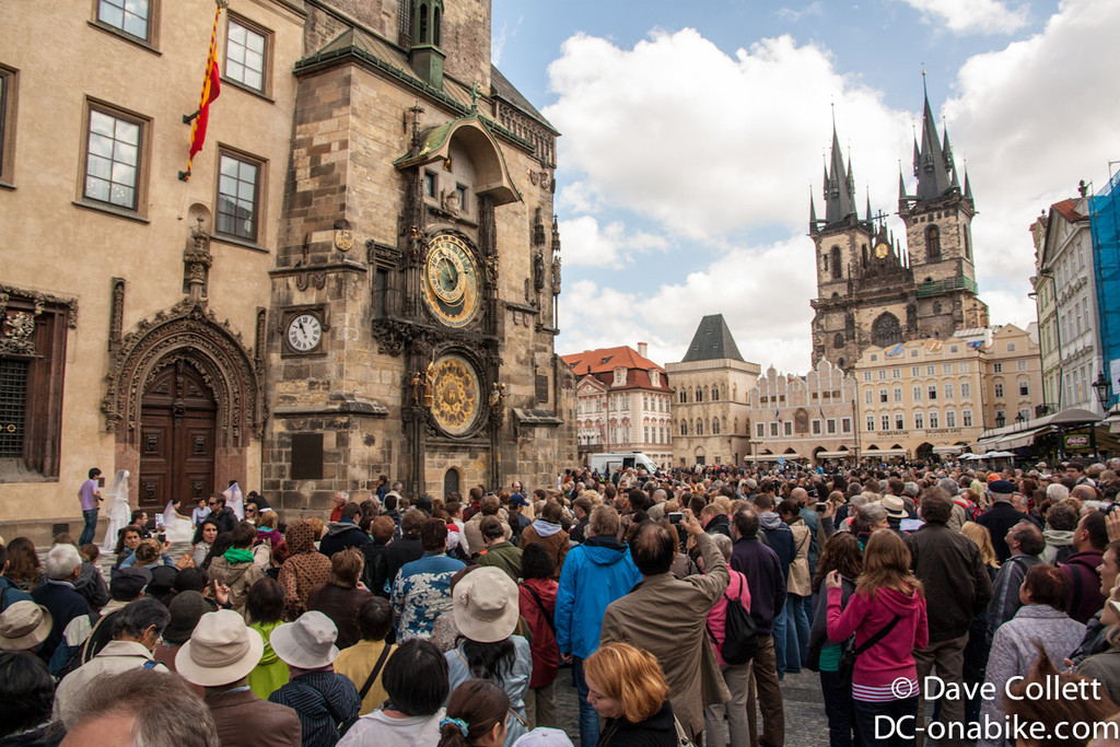 Crowds watching the clock chime