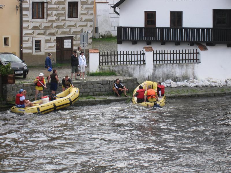 people swimming to shore in Cesky Krumlov