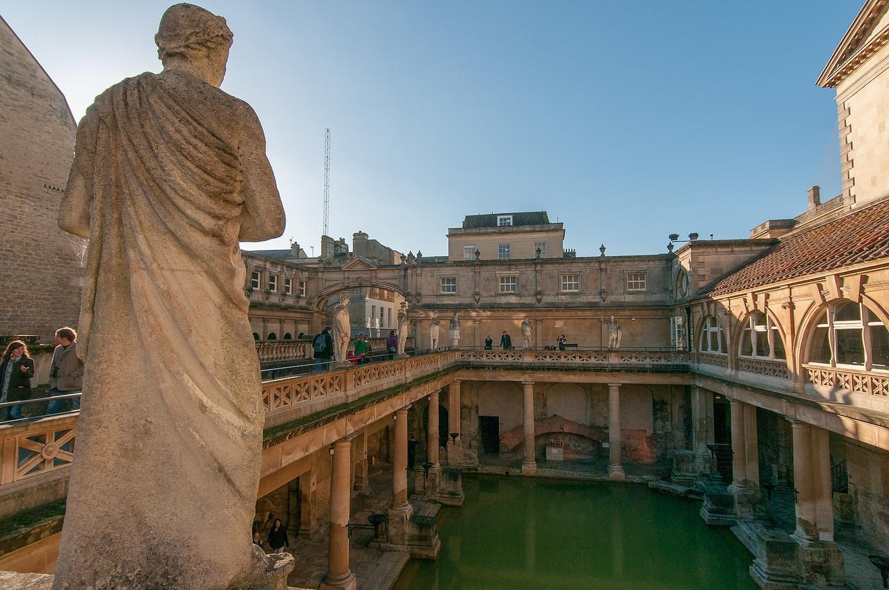 Statue looking down on Roman Baths - Bath, England