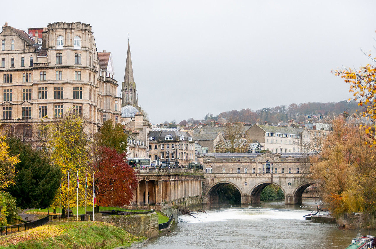 Beautiful autumn leaves and old structures near Pulteney Bridge, Bath, England