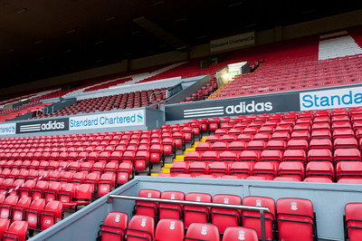 Red bleachers at the Anfield Stadium in Liverpool, England