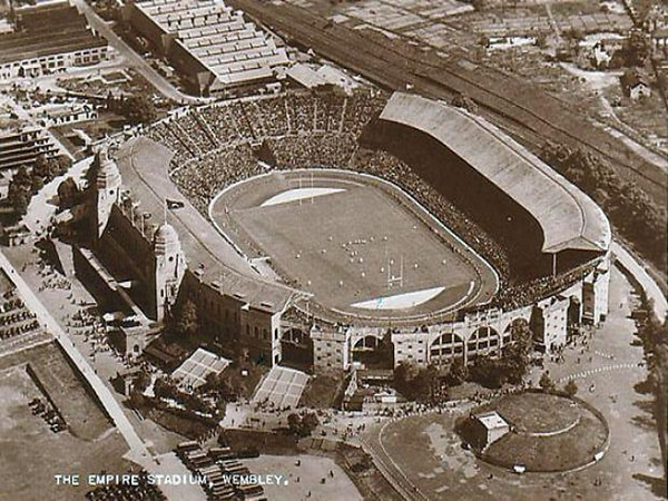 This postcard shows Wembley during the 1957 Rugby League Cup Final in which Leeds beat Barrow 9-7.