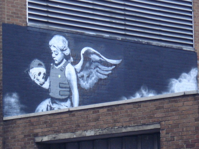 Banksy - Cherub with a bullet proof vest