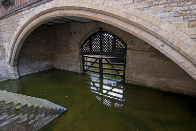 Gate submerged in murky water at the Tower of London - England