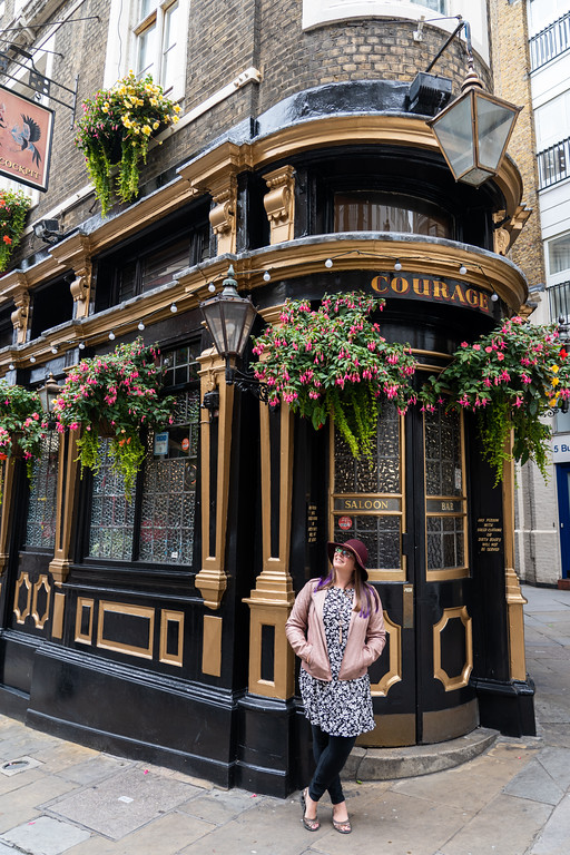 Amanda in front of a pub in London