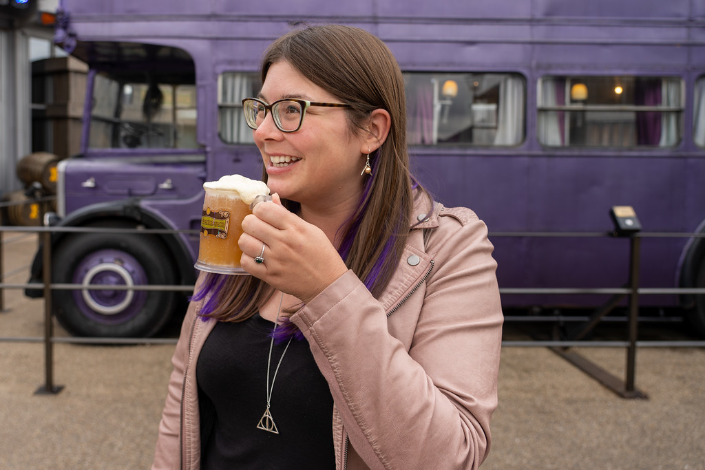 Drinking butterbeer in front of the Knight Bus