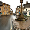 The old market cross. Stow-on-the-Wold is a market town and civil parish in Gloucestershire, England. It is situated on top of an 800ft (244 m) hill, at the convergence of a number of major roads through the Cotswolds, including the Fosse Way (A429). The town was founded as a planned market place by Norman lords to take advantage of trade on the converging roads. Fairs have been held by royal charter since 1330 and an annual horse fair is still held on the edge of the town. There has been a market here since 1107, when Henry II granted a charter, and changed the name of the town from Edwardstow.