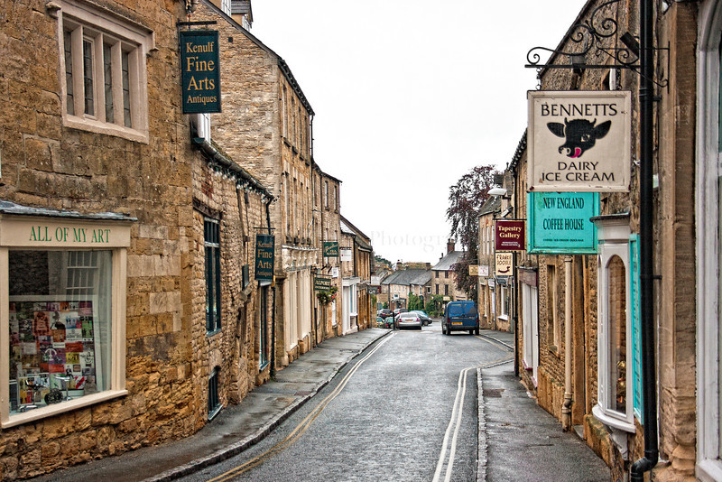 Stow-on-the-Wold is a market town and civil parish in Gloucestershire, England. It is situated on top of an 800 ft (244 m) hill, at the convergence of a number of major roads through the Cotswolds, including the Fosse Way (A429). The town was founded as a planned market place by Norman lords to take advantage of trade on the converging roads. Fairs have been held by royal charter since 1330 and an annual horse fair is still held on the edge of the town. There has been a market here since 1107, when Henry II granted a charter, and changed the name of the town from Edwardstow.