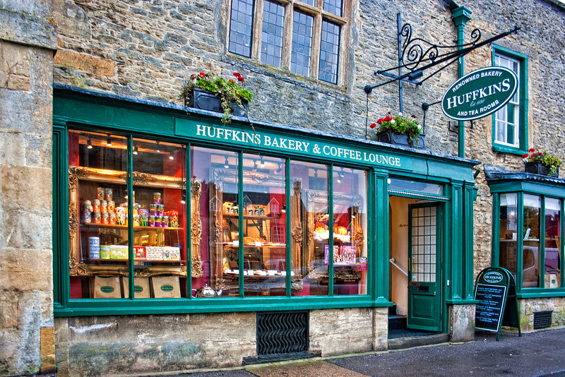Huffkins Bakery and Coffee Lounge. Stow-on-the-Wold is a market town and civil parish in Gloucestershire, England. It is situated on top of an 800 ft (244 m) hill, at the convergence of a number of major roads through the Cotswolds, including the Fosse Way (A429). The town was founded as a planned market place by Norman lords to take advantage of trade on the converging roads. Fairs have been held by royal charter since 1330 and an annual horse fair is still held on the edge of the town. There has been a market here since 1107, when Henry II granted a charter, and changed the name of the town from Edwardstow.
