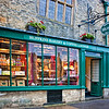 Huffkins Bakery and Coffee Lounge. Stow-on-the-Wold is a market town and civil parish in Gloucestershire, England. It is situated on top of an 800ft (244 m) hill, at the convergence of a number of major roads through the Cotswolds, including the Fosse Way (A429). The town was founded as a planned market place by Norman lords to take advantage of trade on the converging roads. Fairs have been held by royal charter since 1330 and an annual horse fair is still held on the edge of the town. There has been a market here since 1107, when Henry II granted a charter, and changed the name of the town from Edwardstow.