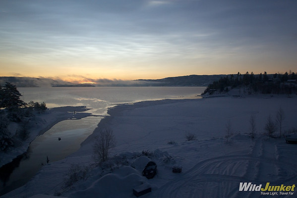 Frozen lake and morning sun