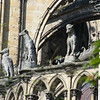 The many gargoyles and figures adorning the building are intricate and fascinating,