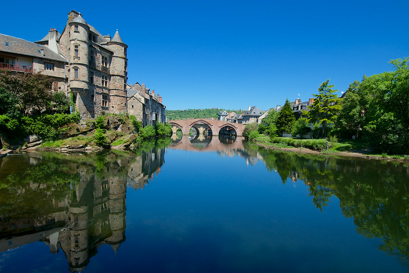 The towers and old bridges of Espalion reflect in the still waters of the river Lot.