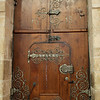 The intricate metalwork on this door from 1618 is another decorative element.
