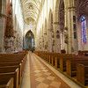with a light, airy interior featuring medieval stained glass windows...