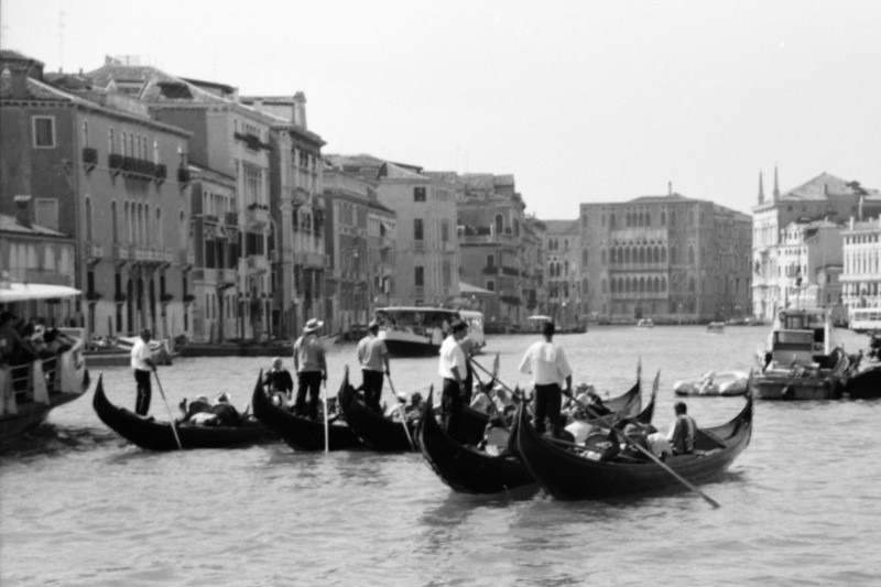 Gondoliers in Black and White - Venice, Italy