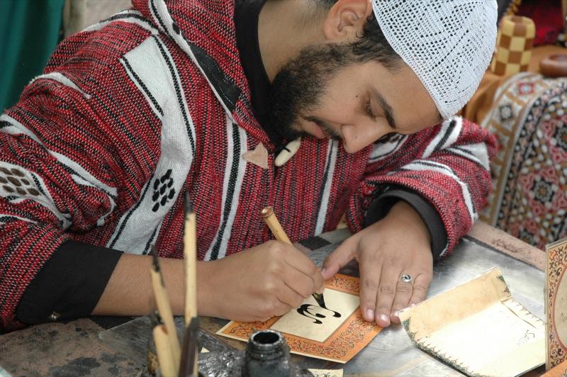 Man Writing in Arabic - Malaga, Spain