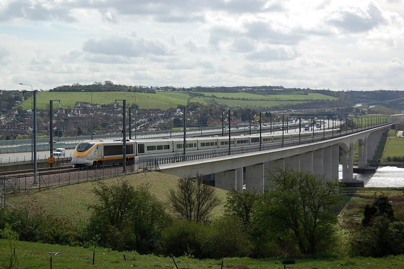 A London bound Eurostar crosses the Medway Viaduct near Rochester, Kent on the 4th April 2011.