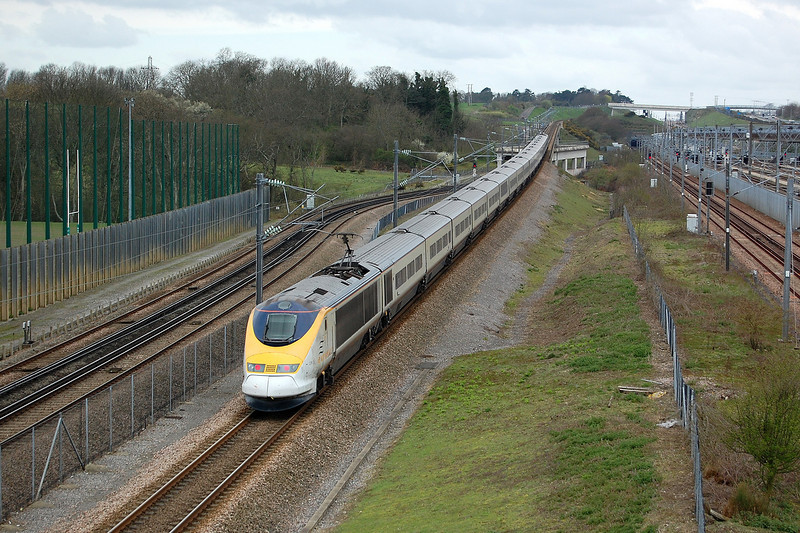A Eurostar joins High Speed 1 as it passes Dollands Moor yard near Folkstone, Kent, on the 4th April 2011.