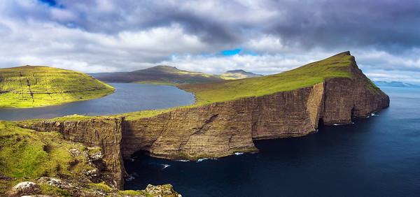 Huge cliff and lake Sorvagsvatn on island of Vagar, Faroe Islands, Denmark.