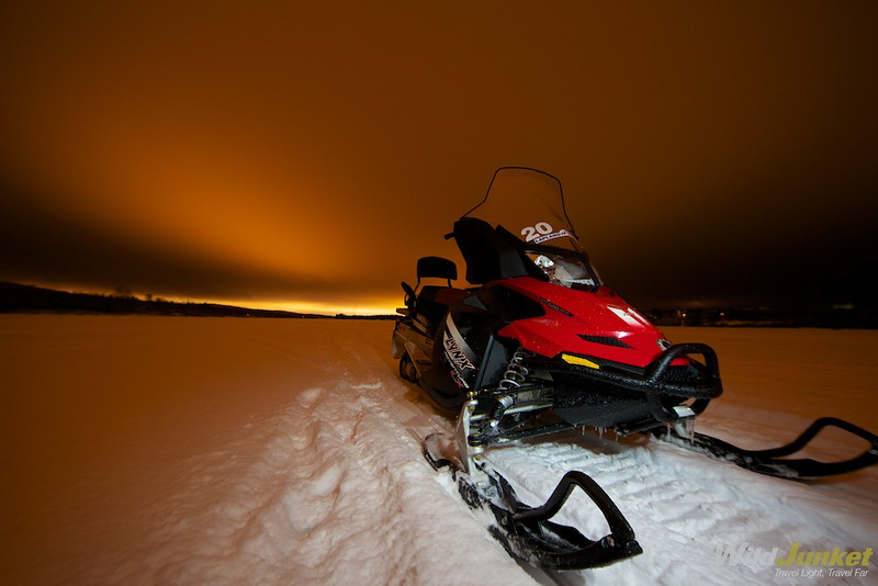 Snowmobile on frozen river