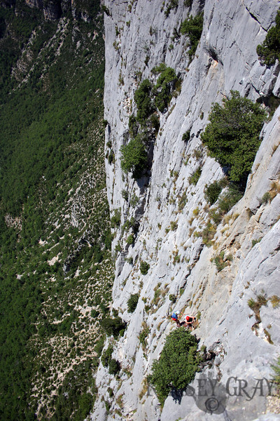 We found our way into Verdon Gorge the next morning and found our way to a great village called La Palud where a great lady from the local climbing shop helped us found some routes we could do. We didn't waste any time and drove right to the climbing areas by about noon we were standing on the cliffs. The approach was incredible! Sometimes there would be people actually belaying off of the viewpoint poles. Thats how close they were to the car! We walked to the climbs we had been told about and I found a few people climbing already. This man and wife were just finished a route. The climbs in this area are around 250meters from bottom to top, all vertical.