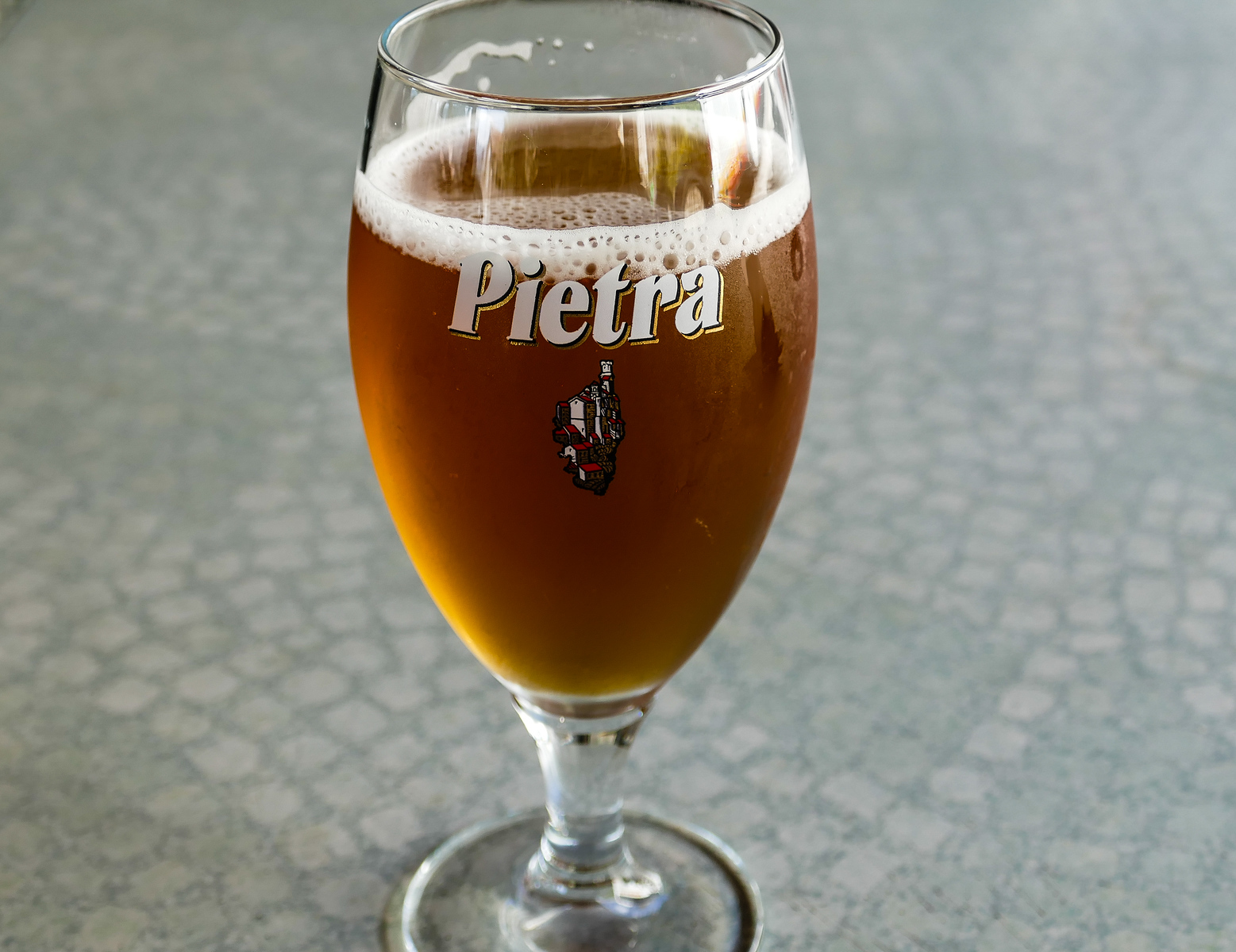 frothy glass of beer