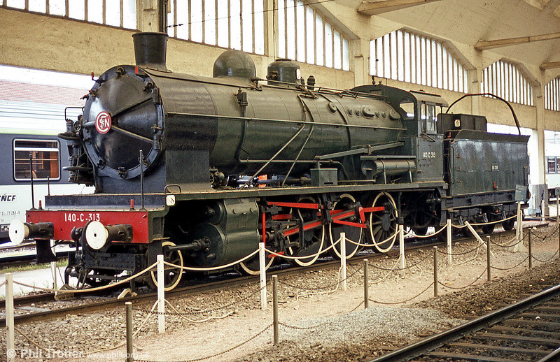 Chemin de Fer de l'État 2-8-0 140C313 on static display at Gare de Reims. Photographed in July 1984.