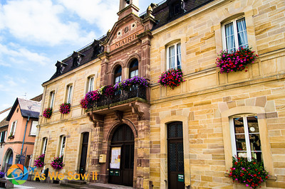 Stone building with beautiful flower bozes