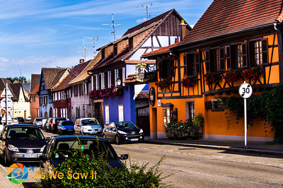 View down a street shows different architectures, from French to German
