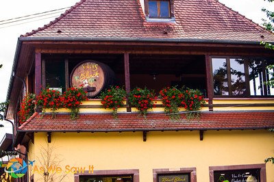 German style building housing a wine shop below and residence above.