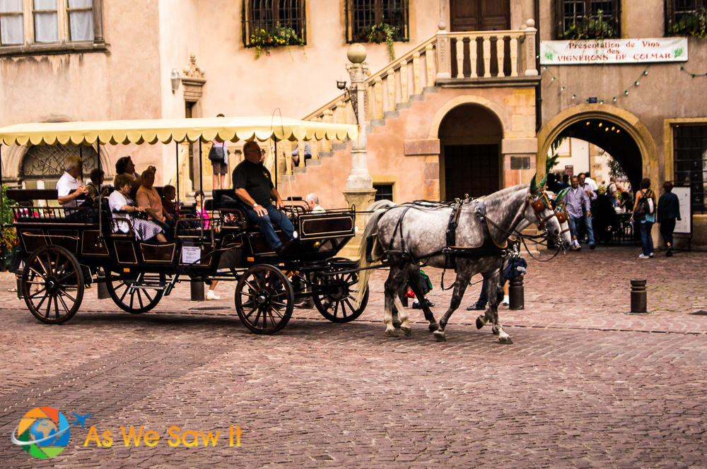 Horse-drawn carriage on cobbled-stone streets in Colmar.
