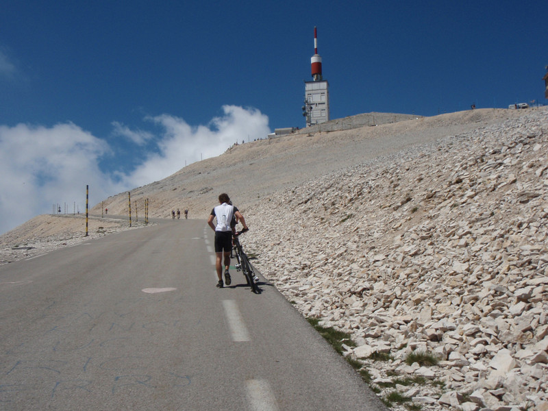 We have less than 500m to the summit and this guy starts walking!