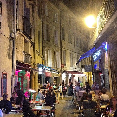 """Audrey's Euro-whim train journey, day 3: En plein air, Montpelier. As the lights go down, life picks up at sidewalk bistros and back alley bars. This is Mediterranean France. Audrey adds this """"I found this little place, had papillote de saumon frais au foie gras & miel. Oh, and chocolate fondant."""" via Instagram http://ift.tt/1IhCre2"""